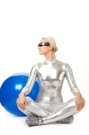 Cyber woman doing yoga exercise photo