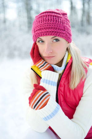 Frozen beautiful woman in winter clothing outdoors  photo
