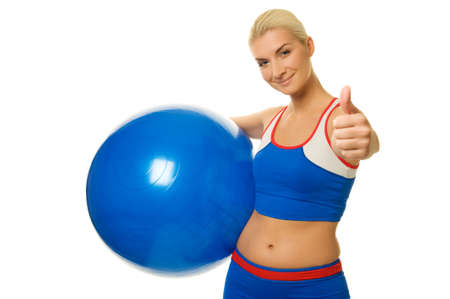 Happy trainer holding a fitness ball  photo