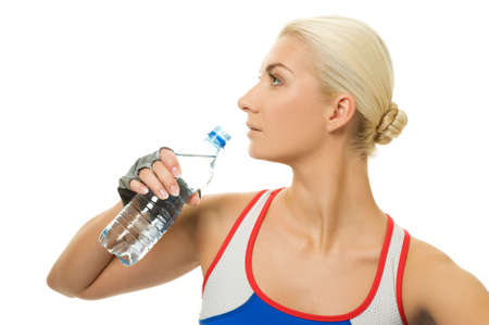 Woman with a bottle of water after training  photo