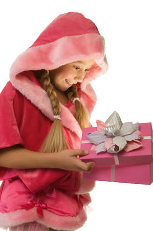 Little Christmas girl open her present      photo