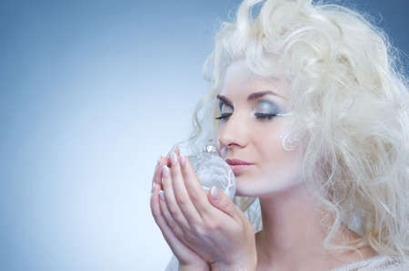 Beautiful snow queen with a christmas ball  photo