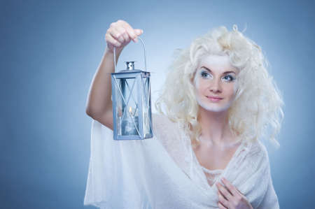Snow queen with a lantern photo