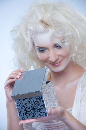 Beautiful snow queen with a christmas box Stock Photo - 5979702