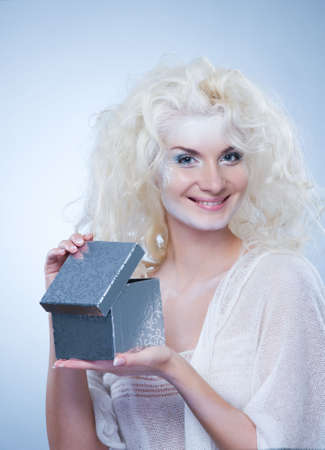 Beautiful snow queen with a christmas box Stock Photo - 5979688