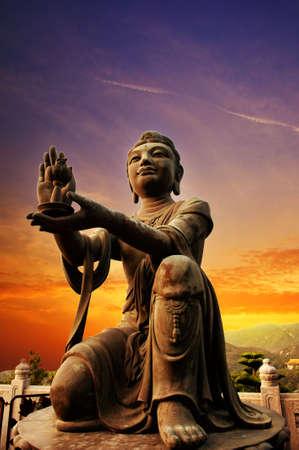 clouds making: Buddhistic statue praising and making offerings to the Tian Tan Buddha (Hong kong, Lantau)