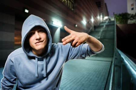 Young handsome men in a hood outdoors      photo