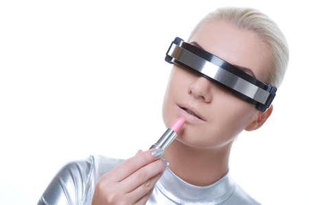 Beautiful cyber woman applying make-up      photo
