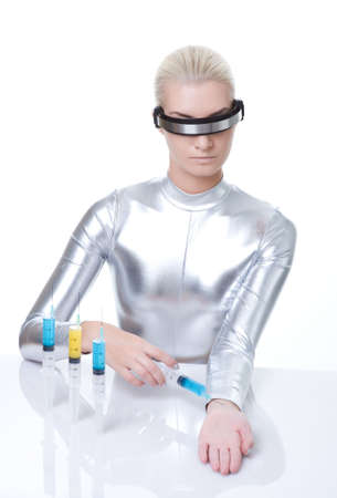 Beautiful cyber woman making injection photo