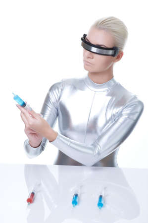Cyber woman choosing syringe   photo