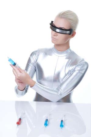 Cyber woman choosing syringe   photo