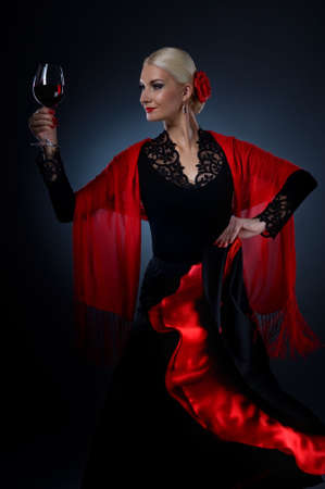 spanish girl: Beautiful flamenco dancer holding a glass of wine