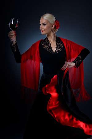 flamenco: Beautiful flamenco dancer holding a glass of wine