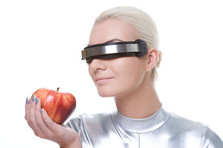 Cyber woman with an apple Stock Photo - 6088499