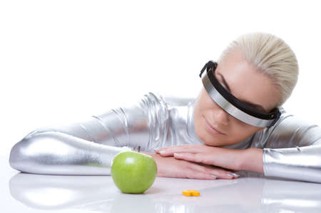 Cyber woman choosing between green apple and pills Stock Photo - 6088434