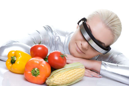 Attractive cyber woman with different vegetables photo