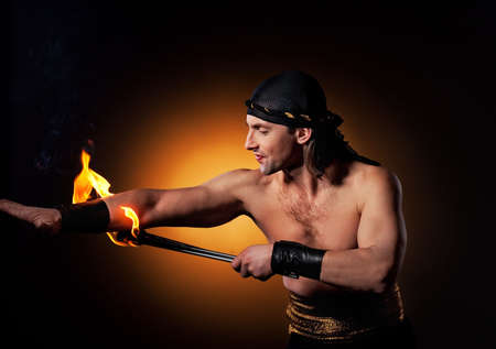 Handsome men performing fire show photo