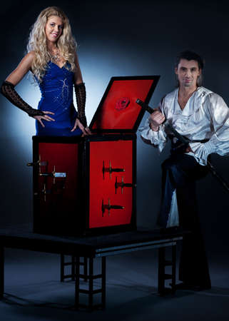 magic box: Attractive couple performing sword box illusion
