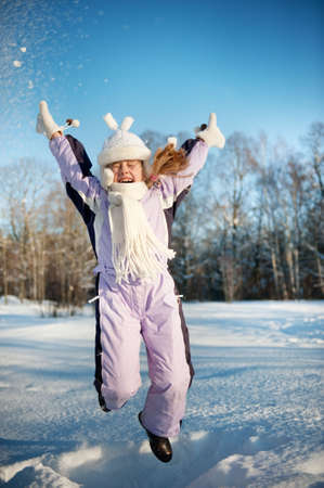 Happy girl jumping in the snow Stock Photo - 6273697