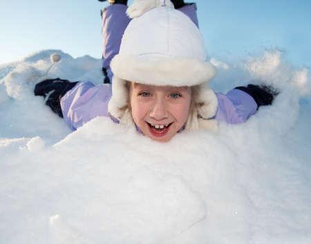 Little girl sliding in the snow Stock Photo - 6273693