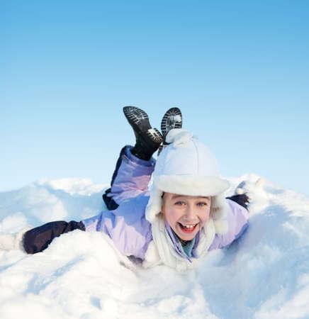 Little girl sliding in the snow photo