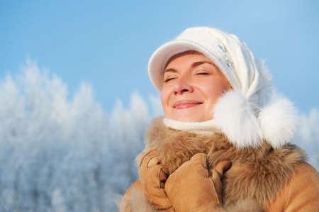 Beautiful woman enjoying winter day photo