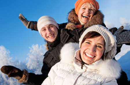 Happy friends on a winter background  photo
