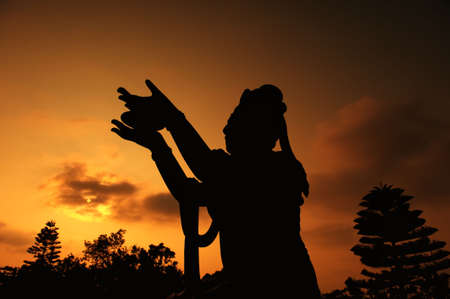Buddhistic statue praising and making offerings to the Tian Tan Buddha (Hong kong, Lantau)  photo