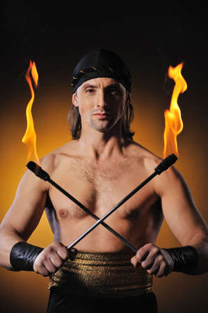 torches: Handsome men holding torches   Stock Photo
