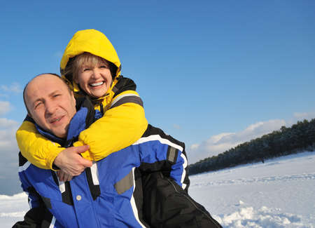 sunny cold days: Middle aged couple having fun on a winter day