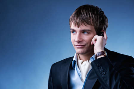 Handsome young businessman with a mobile phone photo
