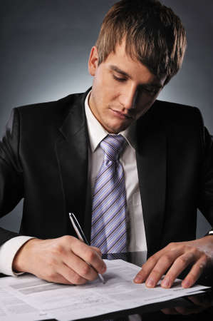 Businessman signing a contract photo