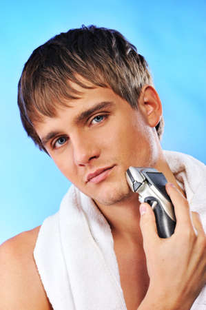 shave: Handsome young man shaving Stock Photo
