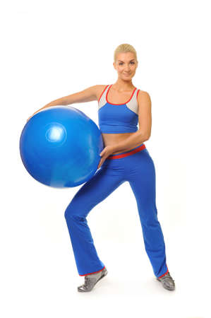 Beautiful fitness trainer with a ball  photo