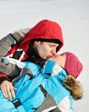 Lovely couple kissing outdoors photo