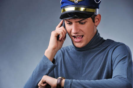 Handsome pilot talking on mobile phone Stock Photo - 6453020
