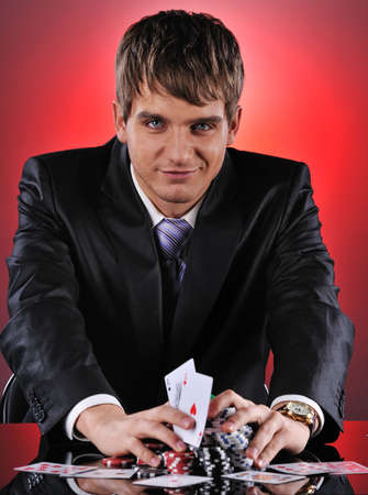 Handsome poker player with two aces in his hands photo