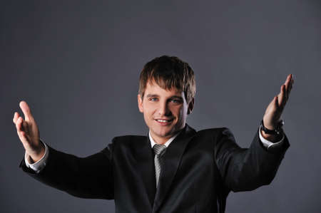 Happy young businessman with open hands photo
