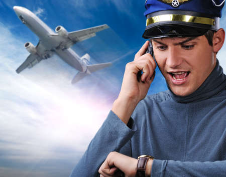 Handsome young pilot against blue sky Stock Photo - 6453022