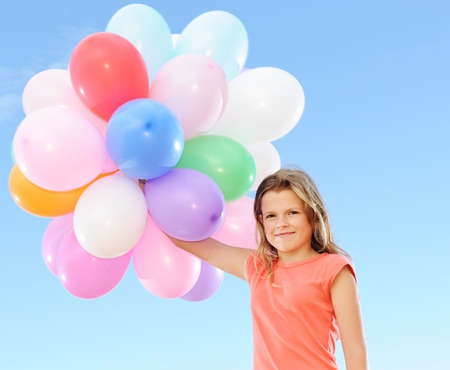 Happy girl with balloons  photo