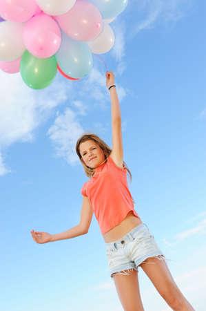 Happy girl with balloons Stock Photo - 6477928