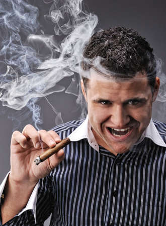 Portrait of a man smoking cigar Stock Photo - 6724626