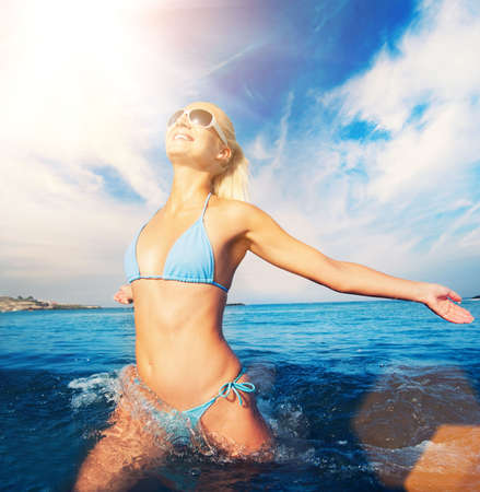 Happy woman running in the sea Stock Photo - 6724555