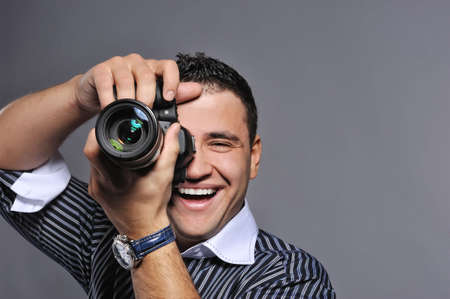 photographer: Photographer making a shot  Stock Photo
