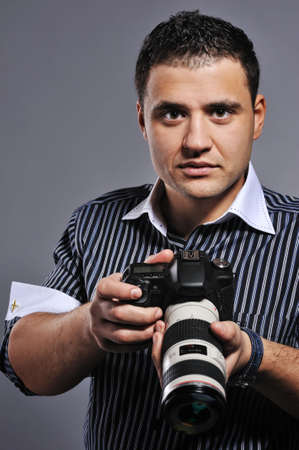 Handsome man with a photocamera Stock Photo - 6724738