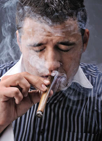 Portrait of a man smoking cigar photo