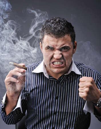 man smoking: Portrait of a man smoking cigar Stock Photo