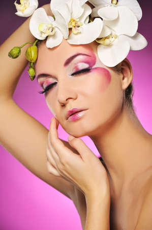 Beautiful woman with creative make-up photo