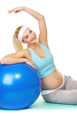 Young pregnant woman making exercise with a fitness ball Stock Photo - 6724492