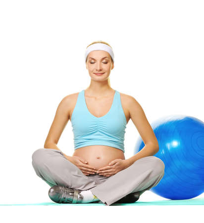 Young pregnant woman making exercise  photo